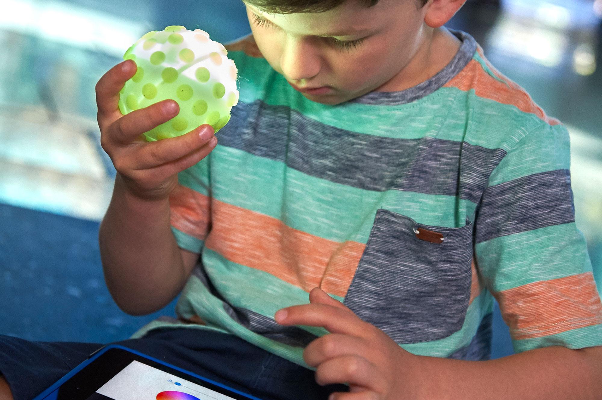 Child with Sphero robot
